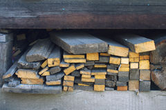 Heap firewood planks. Heap old firewood planks in storage close up Royalty Free Stock Photography