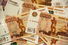 Heap of five thousand russian rubles banknotes Stock Photo
