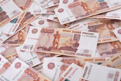 Heap of five thousand russian rubles banknotes. As background Royalty Free Stock Images