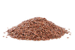 Heap Flax seeds  on white backgrou Stock Photos