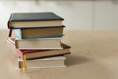 Stack of books on wooden table. Heap fo books on wooden background. Education concept royalty free stock images
