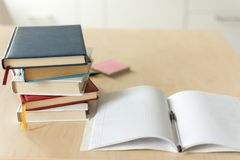 Stack of books on wooden table. Heap fo books on wooden background. Education concept royalty free stock photography