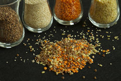Heap from four different groats: buckwheat, lentil, quinoa, bulg Royalty Free Stock Photography