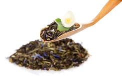 Heap of fragrant tea leaves with cornflower petals Stock Photo