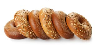 Heap of bagels. Heap of fresh baked bagels on wooden background royalty free stock images