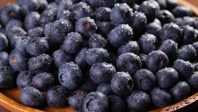 Heap of blueberries. Heap of fresh blueberries rotating. Closeup macro shot. Fresh berry series. 4k stock footage