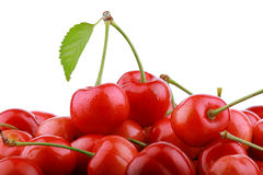 Heap of fresh cherry berries with green leaf isolated Royalty Free Stock Images