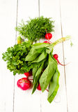 Heap of fresh colorful vegetables on white wooden background. Healthy organic heap of fresh vegetables on a wooden design white background Stock Image