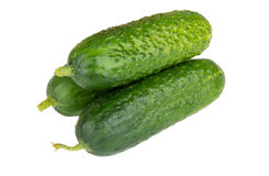 Heap of fresh cucumbers isolated on white Royalty Free Stock Photos