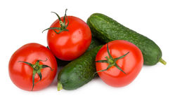 Heap of fresh cucumbers and tomatoes isolated on white Royalty Free Stock Photos