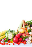 Heap of fresh fruits and vegetables in basket isolated on white. Royalty Free Stock Photography