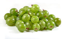 Heap of fresh green gooseberry close up on a white Stock Photography