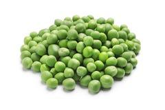 Heap of fresh green peas. On white background Royalty Free Stock Photos