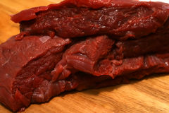 Heap of fresh meat. Red fresh meat with cutted vegetables Stock Images