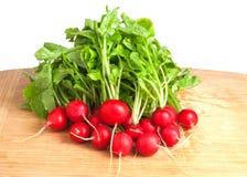Fresh radish on cutting board. Heap of fresh radish on cutting board Royalty Free Stock Images