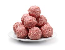 Heap of fresh raw meatballs on plate royalty free stock images