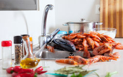 Heap of fresh raw seafoods and spices Stock Images