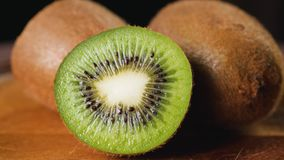 Heap of sliced kiwi. Heap of fresh sliced kiwi fruits rotating. Closeup macro shot. Fresh berry series. 4k stock video