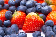 Heap Fresh Strawberries and Blueberries Royalty Free Stock Photo