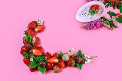Heap of fresh strawberries and chocolate Isolated on pink background. Food Frame Background. top view, free space for text stock photography