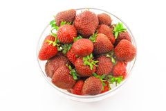 A heap of fresh strawberries in glass bowl Stock Photos
