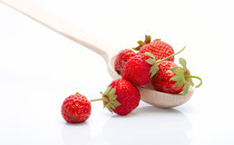 The heap of fresh strawberries in the wooden spoon royalty free stock images