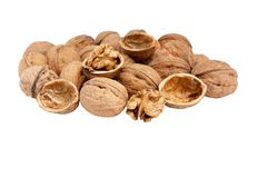 Heap of fresh walnuts isolated on white. Stock Photos