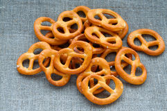 Heap of fresh Wheat salt pretzels on hessian linen Stock Image