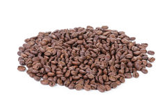 Heap of freshly roasted arabica coffee beans. Isolated Royalty Free Stock Photography