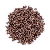 Heap of freshly roasted arabica coffee beans. Isolated Royalty Free Stock Image