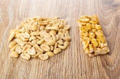 Heap of peanut, kozinaki with peanuts with honey on table royalty free stock photos
