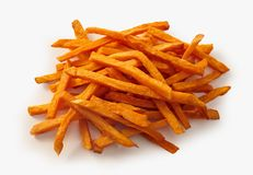 Heap of fried sweet potato chips over white. Heap of fried thin crispy sweet potato chips over white suitable for a menu or advertising royalty free stock photos