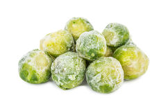 Heap of frozen brussels sprouts isolated on white Royalty Free Stock Photos