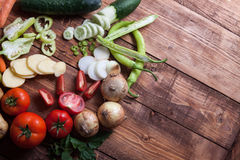 Heap of fruits and vegetables on wooden background Royalty Free Stock Images