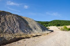 Heap of geology material. Over mountain Royalty Free Stock Photos