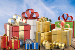 Heap of gift boxes and christmas balls Stock Photos