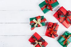 Heap of gift or present boxes on white wooden table top view. Flat lay composition for christmas royalty free stock photography