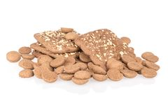 Heap of ginger nuts with speculaas isolated over white Royalty Free Stock Photography