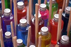 Heap of glasses of colorful flavorings. In stall of street fair Stock Photos