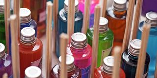 Heap of glasses of colorful flavorings. In stall of street fair Stock Photo