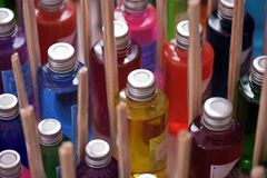 Heap of glasses of colorful flavorings. In stall of street fair Royalty Free Stock Photo