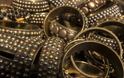 Heap of Gold and Brass decorated bracelets Stock Photo