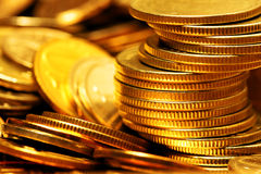 Heap of gold coins. Close-up. Shallow DOF royalty free stock photography