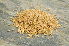 Heap of gold flax seeds Stock Images
