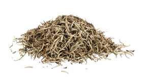 Heap of golden ceylon tea leaves. On white background with clipping path Stock Photos