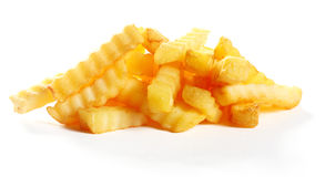 Heap of golden fried crinkle cut potato chips royalty free stock image