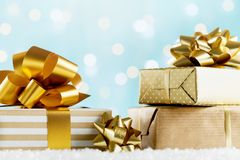 Heap of golden gifts or presents boxes on magic bokeh background. Holiday composition for Christmas or New Year. stock photos