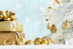 Heap of golden gifts or presents boxes on magic bokeh background. Holiday composition for Christmas or New Year. royalty free stock photography