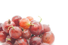 Heap of gooseberries on white. Heap of red gooseberries on white closeup Stock Photos