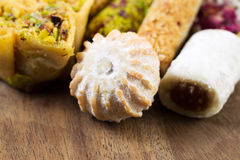 Heap of Gourmet Cookies on Rustic Wooden Board Stock Photo